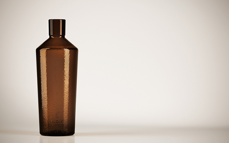 A handcrafted language for industrial bottles with a signature identity